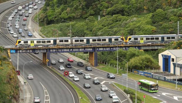 A train traveling over a Wellington highway.