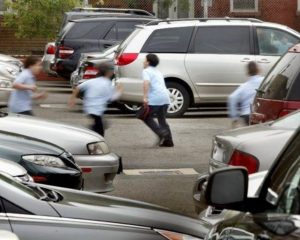 kids in school uniform dashing between parked cars