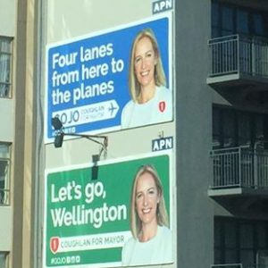 Photo of jo coughlan's mayoral bid billboards saying Four lanes to the planes and let's go wellington